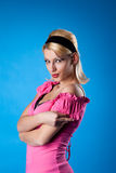 Pretty woman pin-up portrait in rose on blue royalty free stock photos