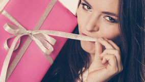 Pretty woman with pink box gift. Christmas holiday Stock Photography