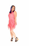 Pretty woman in pink dress. Stock Image