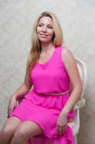 Pretty woman in pink dress Stock Image