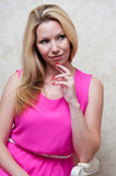 Pretty woman in pink dress Royalty Free Stock Image