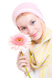 Pretty woman with a pink flower Stock Photography