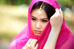 Pretty woman in Pink Indian clothes in posing . Stock Photos