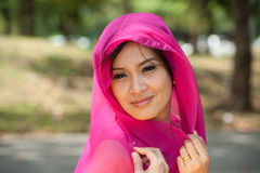 Pretty woman in Pink Indian clothes in posing . Royalty Free Stock Photo