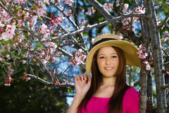 Pretty Woman in Pink under cherry blossoms Royalty Free Stock Image