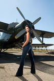 Pretty woman and a plane Stock Photography