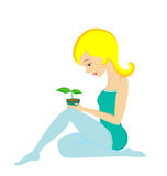 Pretty woman and plant Stock Photography