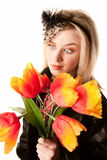 Pretty Woman with Plastic Flowers Royalty Free Stock Photography