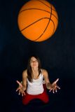 Pretty woman playing basketball Royalty Free Stock Images