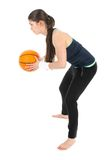 Pretty woman playing basketball, isolated over white stock photos