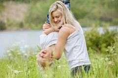 Pretty woman playing with her son Stock Image
