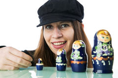 Pretty woman playing with russian dolls Royalty Free Stock Photo