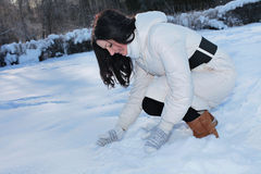 Pretty woman playing with snow Stock Photos
