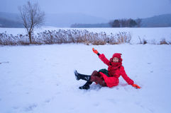 Pretty woman playing in snowfield Stock Photos