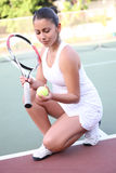Pretty Woman Playing Tennis Stock Photography