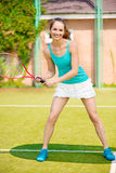 Pretty woman playing tennis Royalty Free Stock Photography
