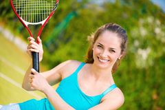 Pretty woman playing tennis Stock Images