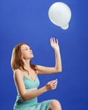 Pretty woman playing with white balloon Stock Photography