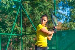 Pretty woman plays tennis Stock Photos