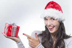 Pretty woman pointing at a gift Royalty Free Stock Photo