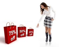 Pretty woman pointing the shopping bags Royalty Free Stock Photography