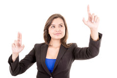 Pretty woman pointing at something in the air Stock Photo