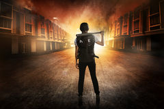 Pretty woman in police vest holding baseball bat Royalty Free Stock Photo