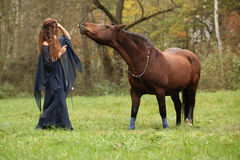 Pretty woman with pony - NHS Royalty Free Stock Image