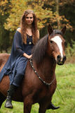 Pretty woman with pony - NHS Royalty Free Stock Photo