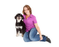Pretty Woman With Poodle Mix Dog Royalty Free Stock Images