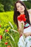 Pretty woman in poppy flowers Stock Photo