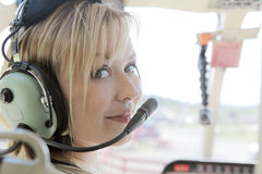 Pretty pilot. Portrait of a pretty woman in a helicopter Royalty Free Stock Photos