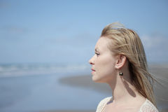 Pretty woman. Portrait of a pretty woman on the beach Stock Photos