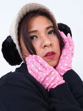 Pretty woman portrait with gloves and ear muffs Royalty Free Stock Photography