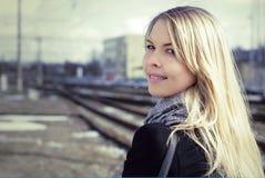 Pretty woman portrait near the rail lines Stock Photography