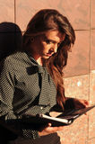 Pretty woman portrait near wall with notepad Royalty Free Stock Images