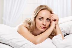 Pretty Woman portrait on pillows Stock Photo