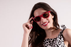 Pretty woman portrait in red sunglasses Royalty Free Stock Photography