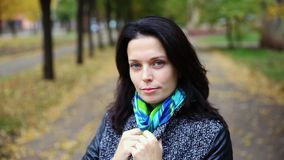 Pretty woman portrait smiling outdoors in the autumn park stock footage