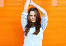 Pretty woman posing against bright colorful wall Royalty Free Stock Photos