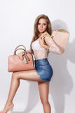 Pretty woman posing with bags Royalty Free Stock Photography
