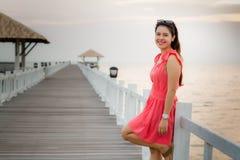 Pretty woman posing on the bridge. stock photos