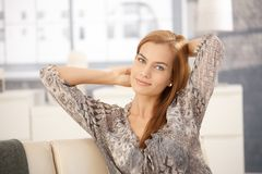 Pretty woman posing on couch Stock Photo