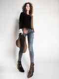 Pretty woman posing in denim pants and boots and black hat - intentional motion blur Royalty Free Stock Images