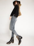 Pretty woman posing in denim pants and boots and black hat - intentional motion blur Royalty Free Stock Photos