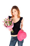 Pretty Woman Posing with Flowers Stock Images