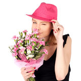 Pretty Woman Posing with Flowers Stock Photos
