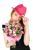 Pretty Woman Posing with Flowers Stock Image