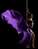 Pretty woman posing with flying veil in pole dance Royalty Free Stock Image
