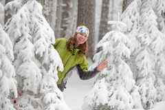 Pretty woman is posing in frozen winter forest Royalty Free Stock Image